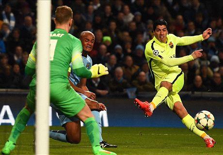 Super Suarez makes Man City suffer