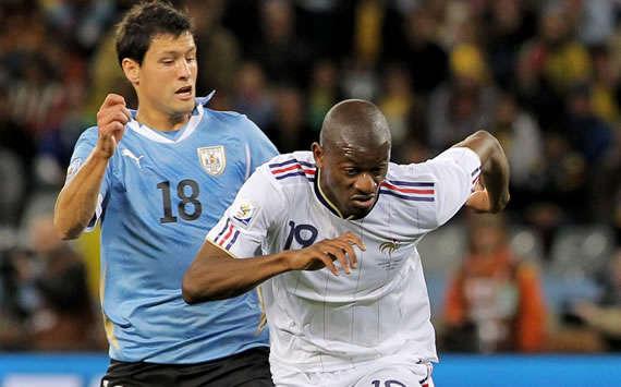 Ignacio Gonzalez (Uruguay) vs Abou Diaby (France) - (Gettyimages)