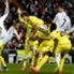 Real Madrid and Villarreal's players vie for a corner