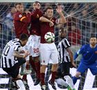 Ten-man Roma fight back for a point