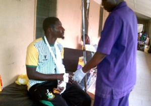 Kano Pillars' Adamu Murtala undergoing treatment after Thursday's attack on their team bus
