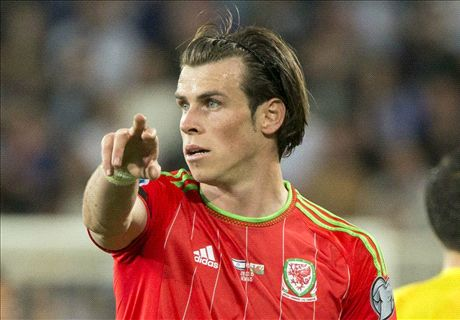Bale and Ramsey send Wales top