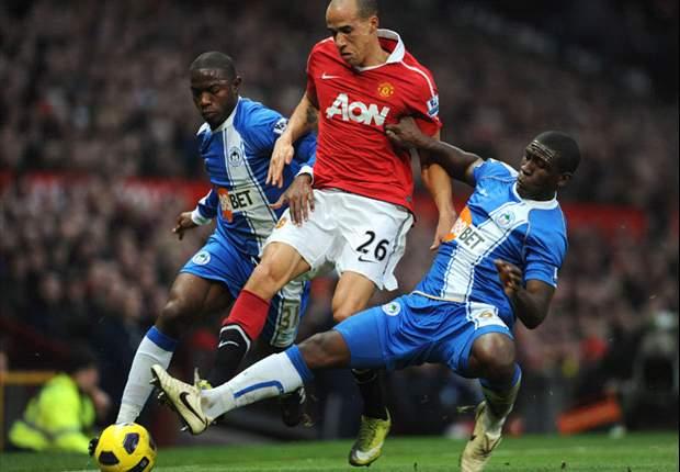 Manchester United 2-0 Wigan Athletic: Evra & Hernandez move Red Devils joint top as Rooney returns against nine-man visitors