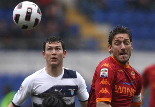 Roma 2-0 Lazio: Francesco Totti double seals Rome derby as visitors reduced to nine