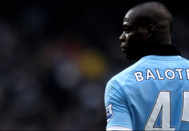 Manchester City striker Mario Balotelli caught throwing darts at youth-team players - report