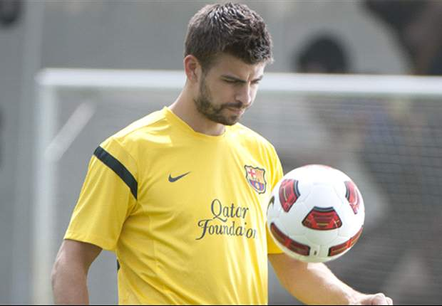 Barcelona's Gerard Pique out for two weeks with hamstring injury