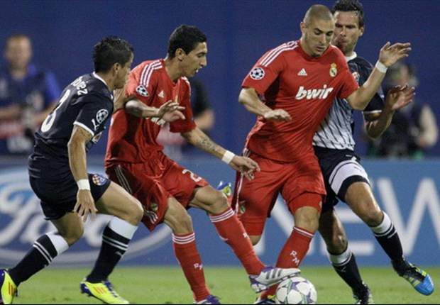 Angel in red - match-winner Di Maria proves how important he is to Jose Mourinho in Real Madrid's new kit