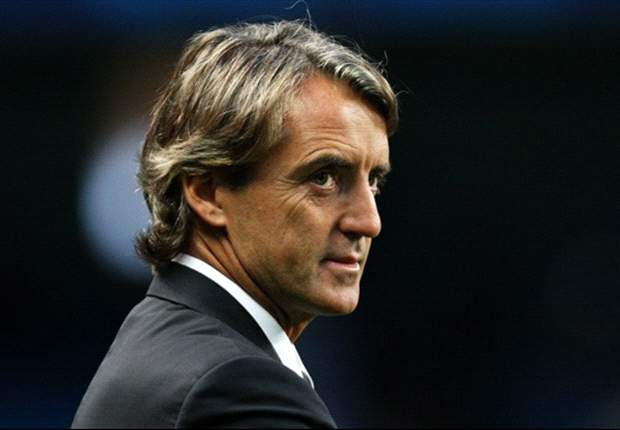 Manchester City boss Roberto Mancini happy to go to Old Trafford for United derby as league leader