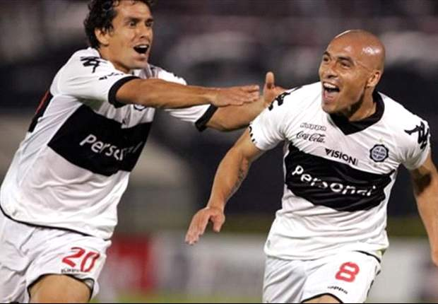 Copa Libertadores: Marin and Biancucchi on target as Olimpia sink Lanus while Junior salvage a point in Chile