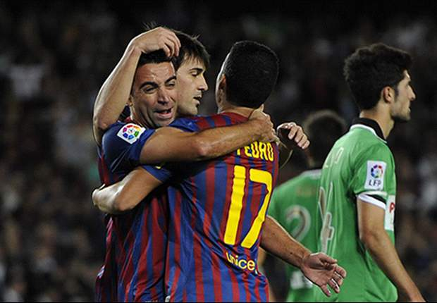 Barcelona 3-0 Racing Santander: Messi imperious once again as the champions return to Primera Division summit
