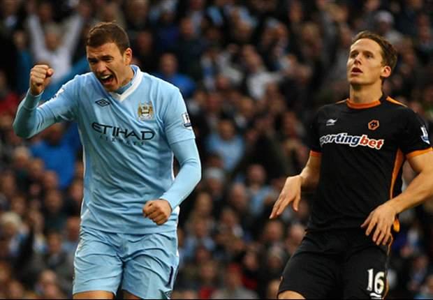 Manchester City 3-1 Wolves: Dzeko, Kolarov and Johnson maintain unbeaten league start for 10-man hosts