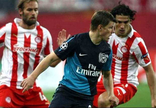 Arsene Wenger optimistic about Arsenal's young players but says midfield showed lack of experience against Olympiakos