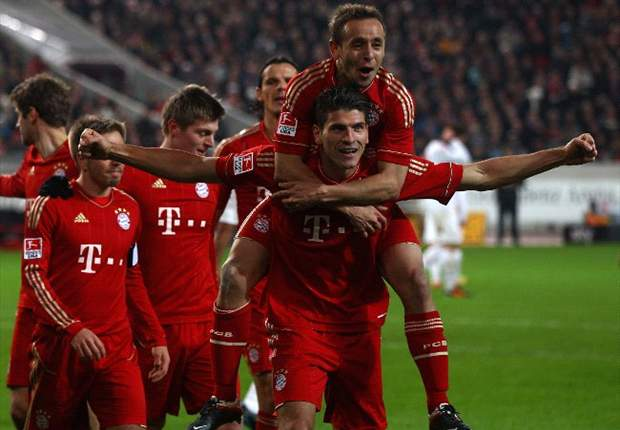 Stuttgart 1-2 Bayern Munich: Gomez nets double to see off stubborn 10-man hosts as Bavarians open up three-point gap at Bundesliga summit