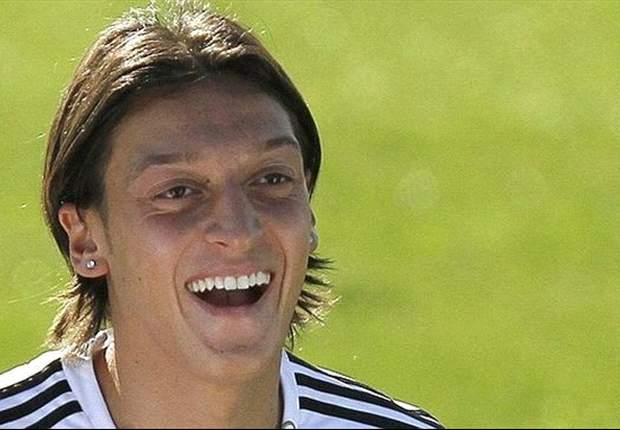 Real Madrid's Mesut Ozil refuses to comment on Liverpool link