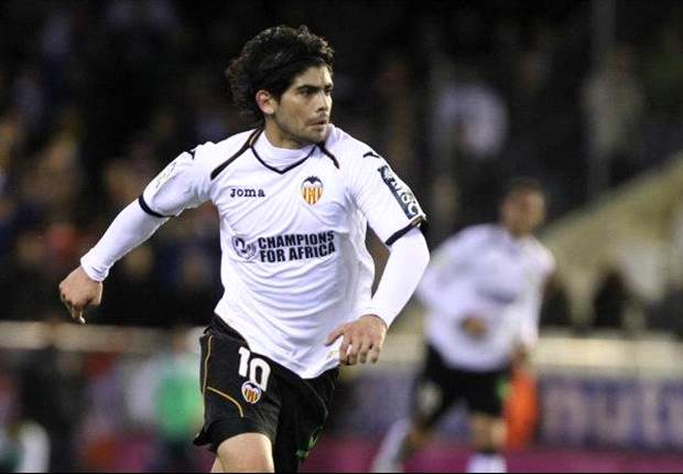 Valencia's Banega out for six months after undergoing ankle surgery