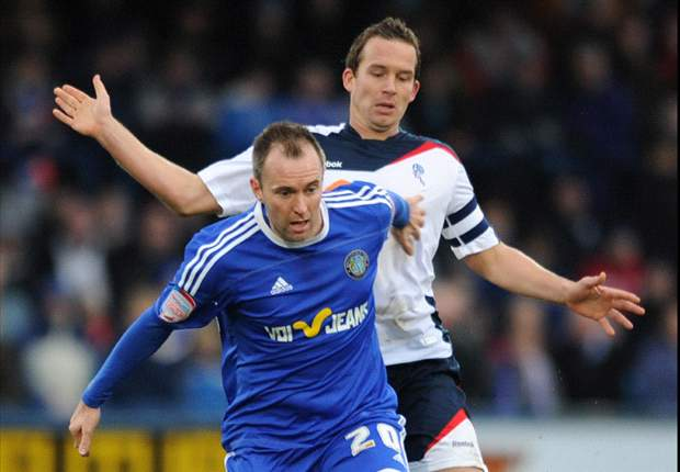 Bolton manager Owen Coyle praises captain Kevin Davies following 2-0 victory over Macclesfield