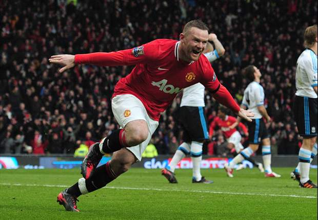 Manchester United 2-1 Liverpool: Wayne Rooney double sends hosts top as Luis Suarez scores after snubbing Evra handshake