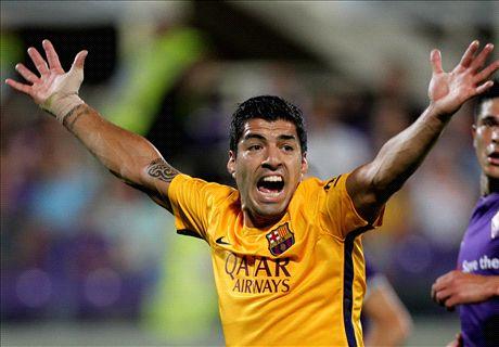 Barca slip to defeat despite Suarez strike