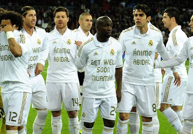 Real Madrid show their class off the pitch with Abidal & Muamba T-shirt tribute, but fail to do so on it as Liga lead over Barcelona is cut to eight points