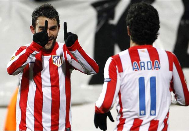 Atletico Madrid 2-1 Malaga: Simeone's side stay in the hunt for Champions League qualification