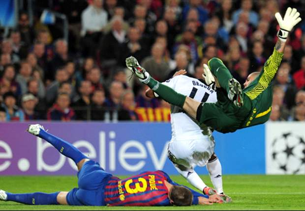 Pique taken to hospital after Victor Valdes collision
