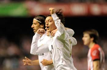 Ozil proud of Real Madrid for leaving Barcelona trailing in their wake