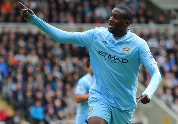 Yaya Toure delighted with Mancini's new Manchester City deal