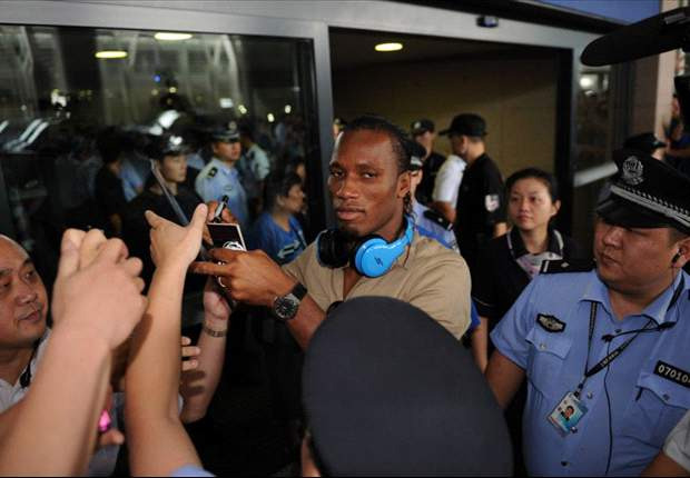 Shanghai Shenhua fans turn out in force as Didier Drogba arrives in China