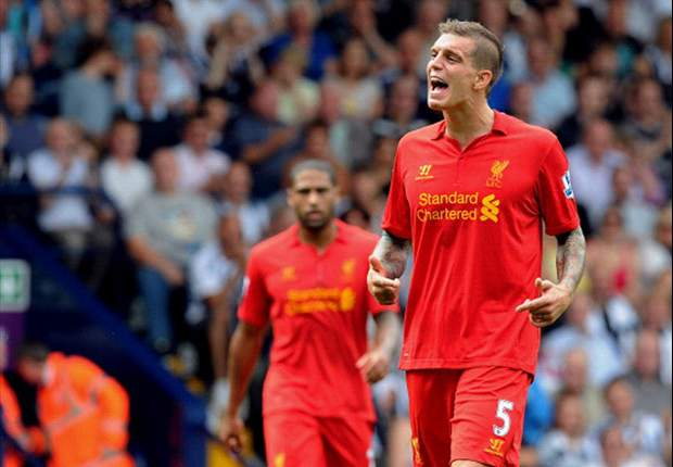 Agger intends to fulfil Liverpool contract despite Barcelona link