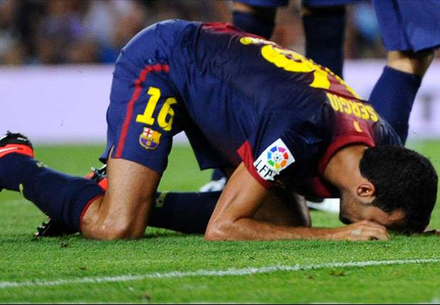 Busquets defends against diver label