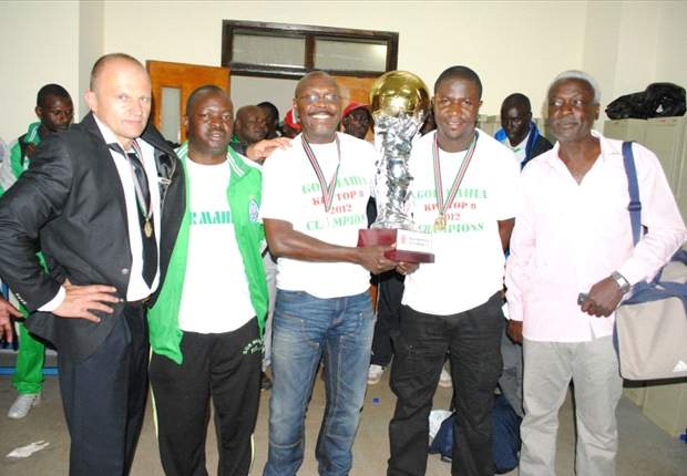 Gor Mahia chairman Rachiel and coach Logarusic with other members of the team