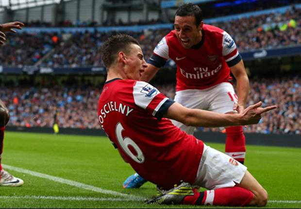 Manchester City 1-1 Arsenal: Koscielny saves point for Gunners after Lescott opener