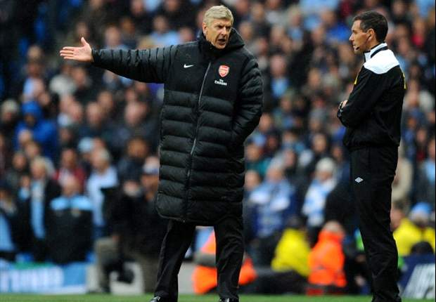 Wenger insists Arsenal are still in title race