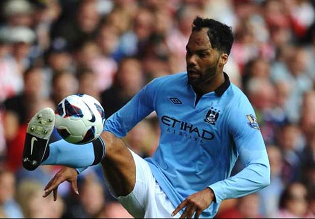 Lescott: I am happy to stay and fight for my place at Manchester City