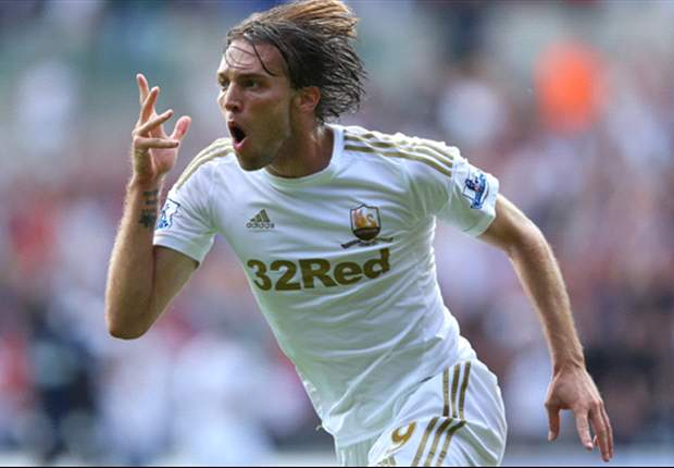 Michu not going anywhere for less than 30 million pounds, insists Swansea boss Laudrup