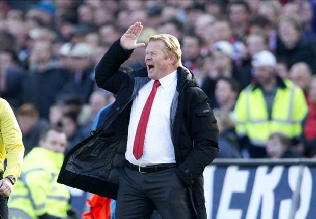 Koeman signs Feyenoord extension until 2014