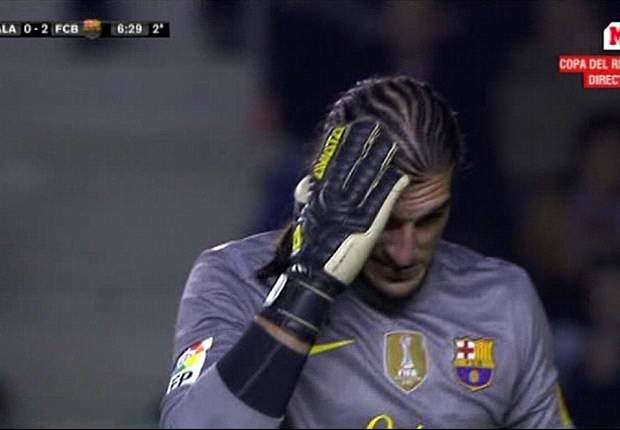 Barcelona keeper Pinto plays down head injury after being hit by missile