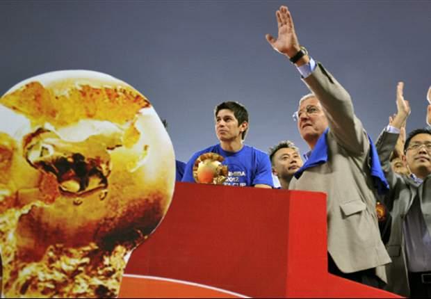 Darío Conca y Lucas Barrios, campeones en China