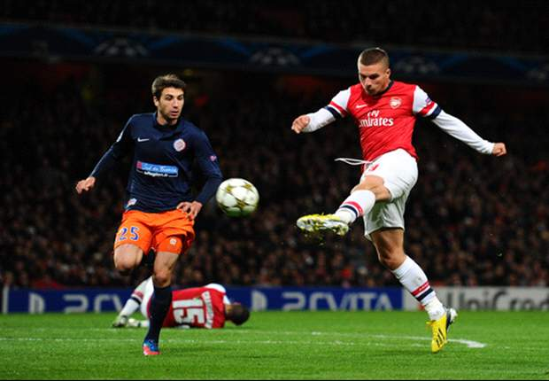 Arsenal 2-0 Montpellier: Wilshere & Podolski strikes send Gunners through