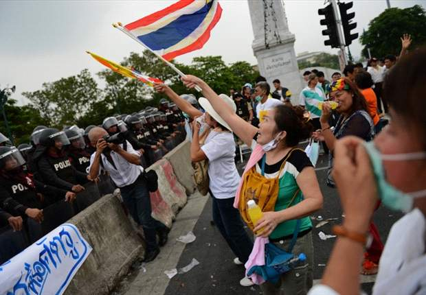 Trouble-free opening day of 2012 AFF Suzuki Cup in Thailand despite political demonstrations across the city