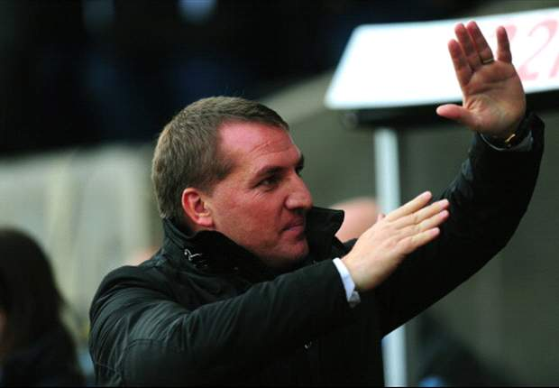 Rodgers defends Suarez after handball incident