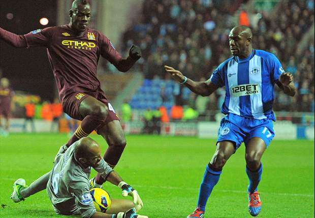 Wigan 0-2 Manchester City: Balotelli & Milner stunner keep visitors hot on United's tail