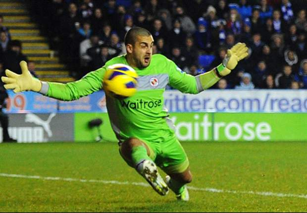 Reading goalkeeper Adam Federici gets support from former coach
