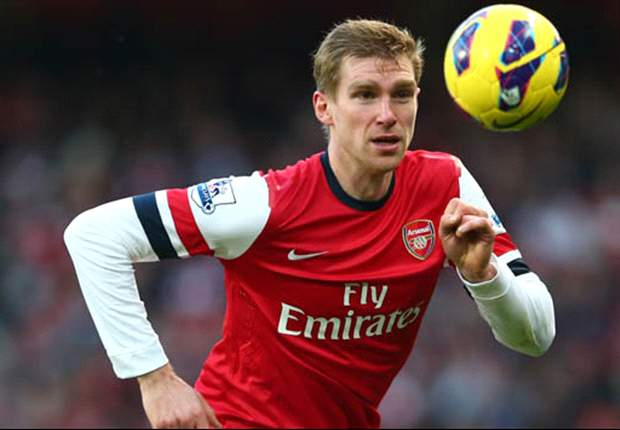 Mertesacker not easy on the eye but he's efficient, says Wenger
