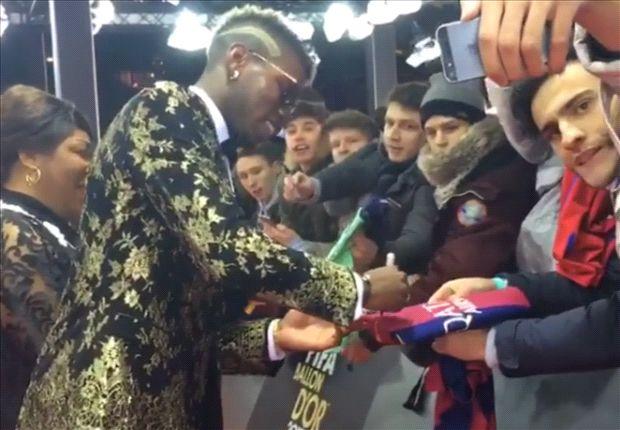 Pogba signs... a Barcelona shirt?!