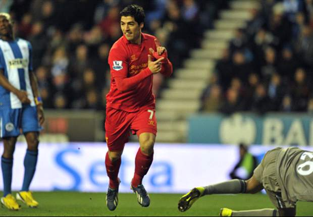 Wigan 0-4 Liverpool: Suarez hat-trick fires Reds to thumping win