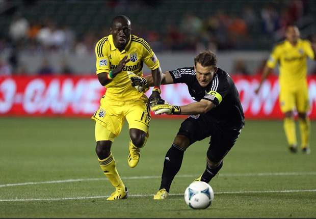 Dominic Oduro, Columbus Crew; being challenged by Dan Kennedy, Chivas USA