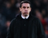 Wenger takes jab at Neville