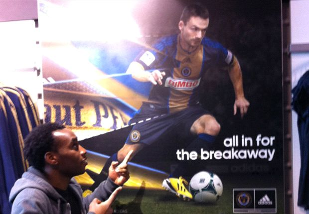 "Amobi looking at Jack ""American Chicharito"" McInerney's Adidas poster"