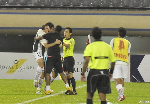Warriors FC coach V. Selvaraj celebrates with goalscorer Mislav Karoglan